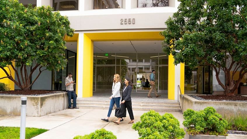 Lifestyle photography of the building entrance of SIlicon Valley Center - 2550 N First Street in San Jose, CA