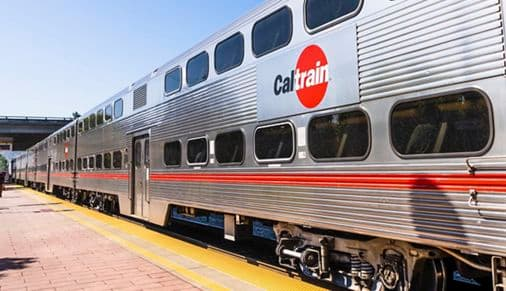 Aug 15, 2019 San Mateo / CA / USA - Close up of Caltrain car; logo printed on the side; Caltrain is a California commuter rail line on the San Francisco Peninsula and in the Santa Clara Valley