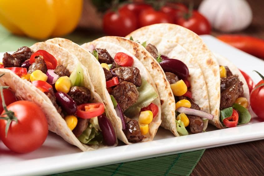 Serving taco with beef and vegetables